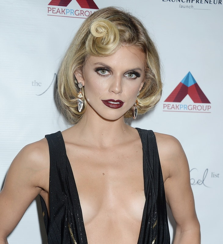 annalynne-mccord-deep-cleavage-at-her-sister-s-birthday-party-01