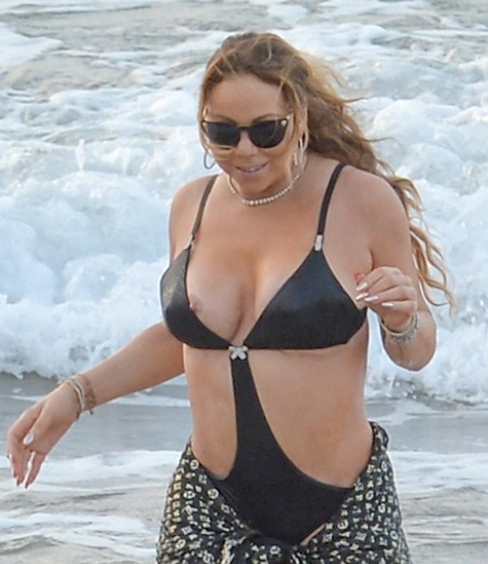 mariah-carey-nipple-slip-at-the-beach-in-maui-hawaii-14