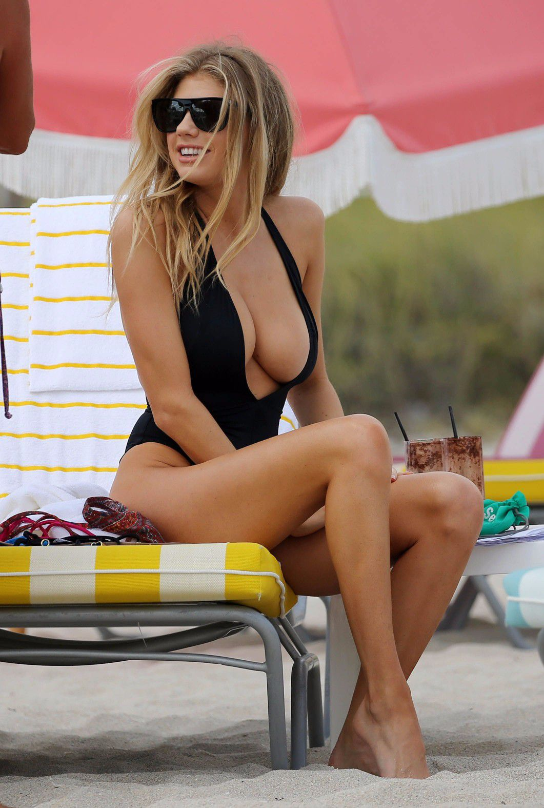 charlotte-mckinney-nipple-slip-at-the-beach-in-miami-03