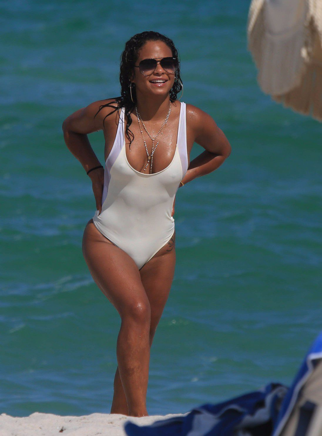 Christina-Milian-Pokies-In-White-Swimsuit-On-The-Beach-In -1909