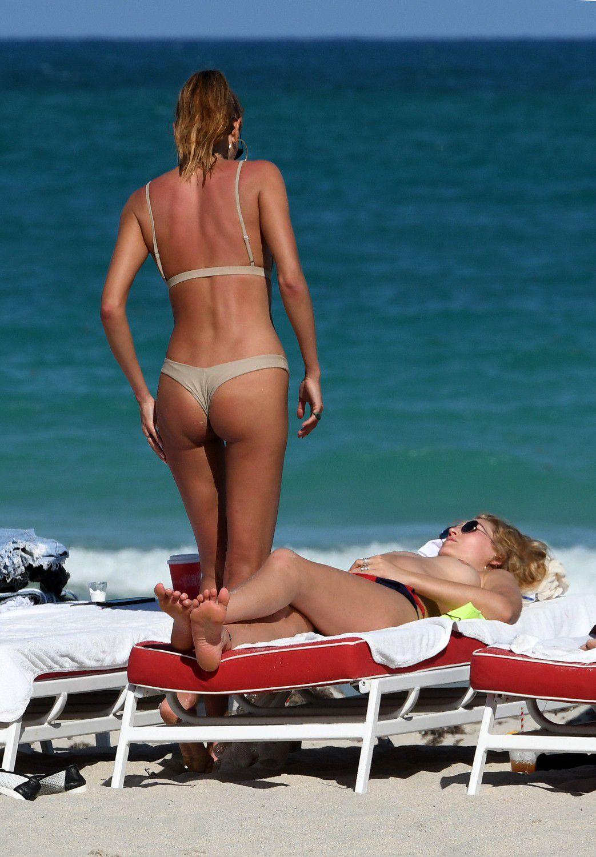 toni-garrn-sunbathing-topless-on-the-beach-in-miami-1987