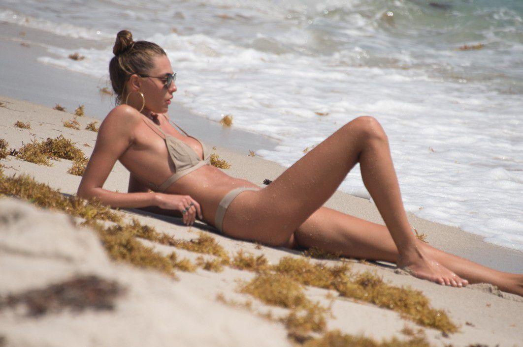 toni-garrn-sunbathing-topless-on-the-beach-in-miami-2676