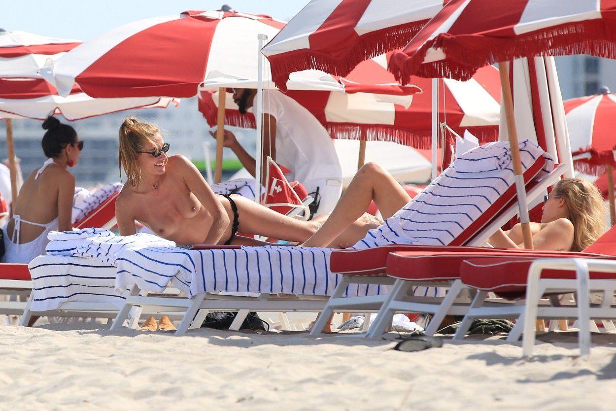 toni-garrn-sunbathing-topless-on-the-beach-in-miami-5878