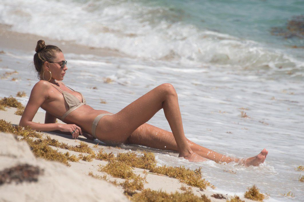 toni-garrn-sunbathing-topless-on-the-beach-in-miami-8253