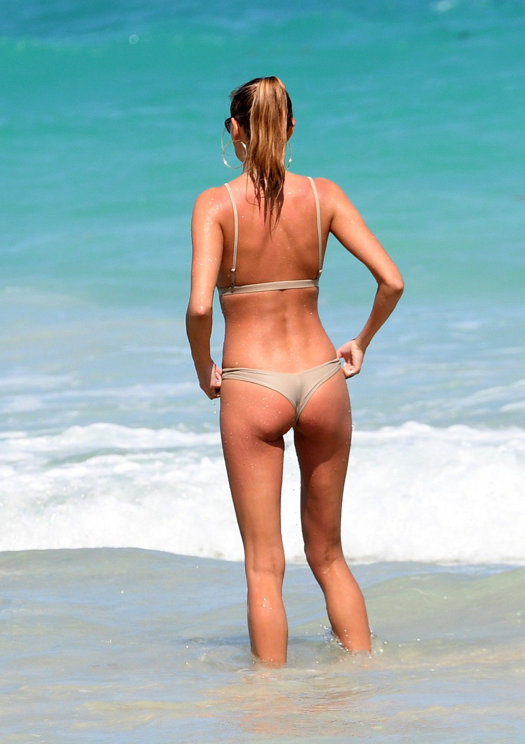 toni-garrn-sunbathing-topless-on-the-beach-in-miami-9361