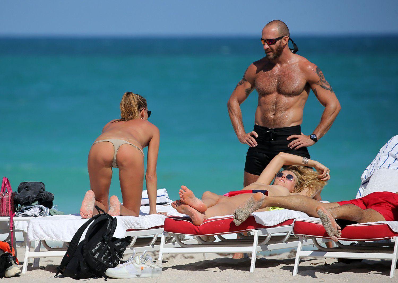 toni-garrn-sunbathing-topless-on-the-beach-in-miami-9460