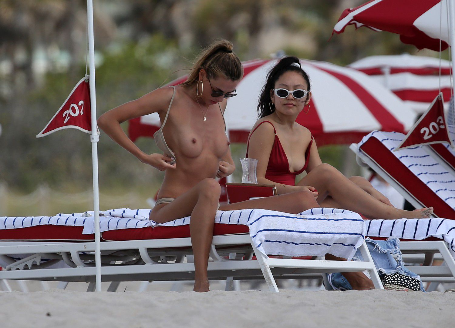 toni-garrn-sunbathing-topless-on-the-beach-in-miami-9721